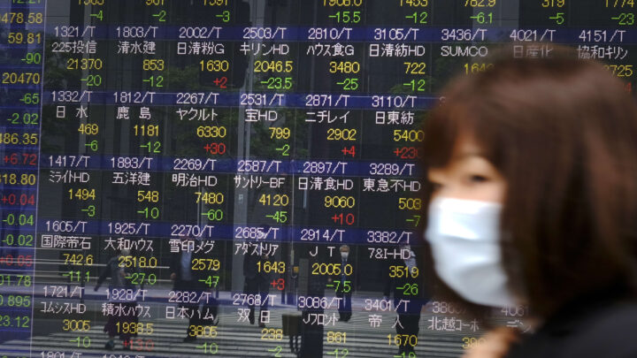Asia-Pacific markets mixed as investors react to comments from Fed's Powell