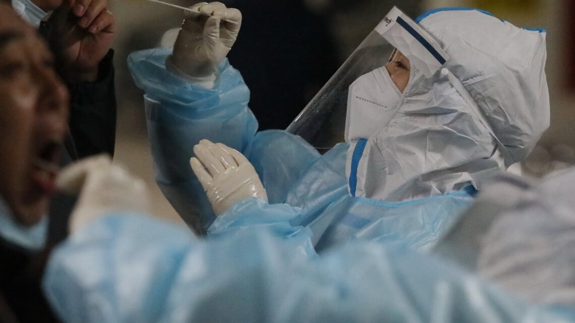 China reports first Covid death in more than six months as WHO investigators arrive