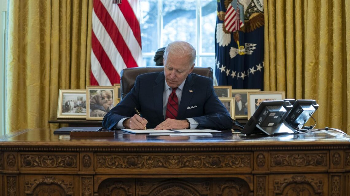In early going, Biden floods the zone with decrees